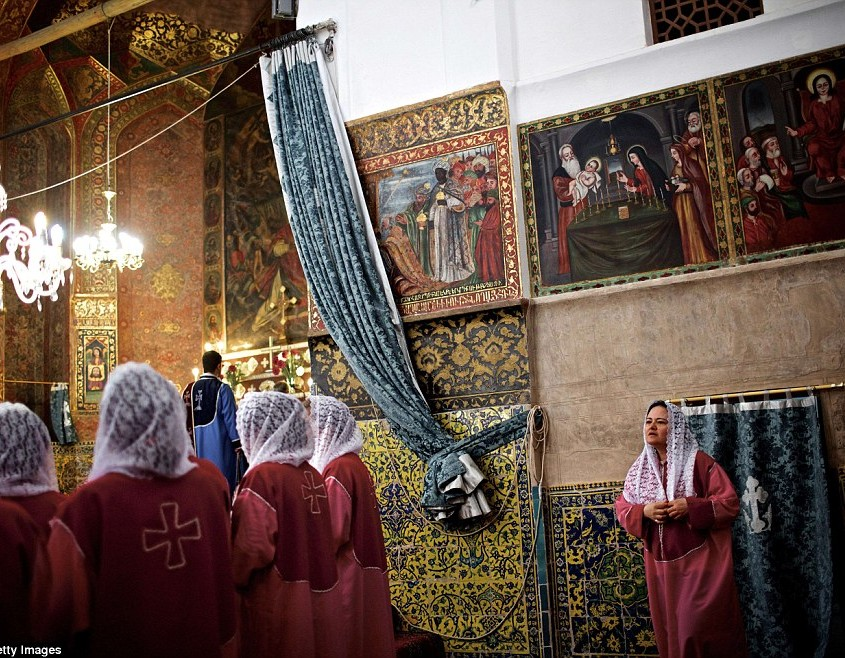 An Iranian Armenian choir sings religious songs during a week-end mass at the Saint Stepanos church in the Julfa neighbourhood of the historic city of Isfahan