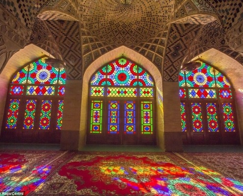 As the sun shines through the stained glass windows at Nasir al-Mulk Mosque, its dominant red hue is highlighted in a kaleidoscope of colours