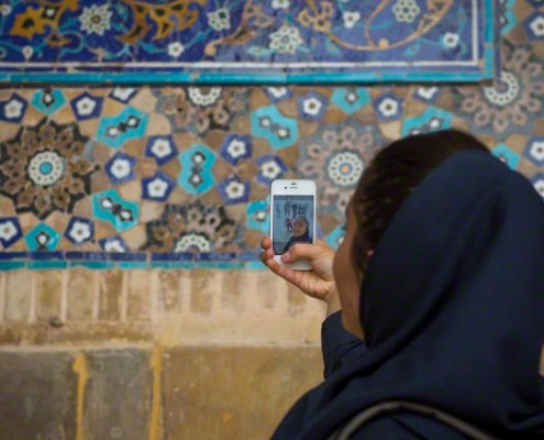 Iran, Isfahan Province, Isfahan, iranian tourist taking picture with her mobile phone