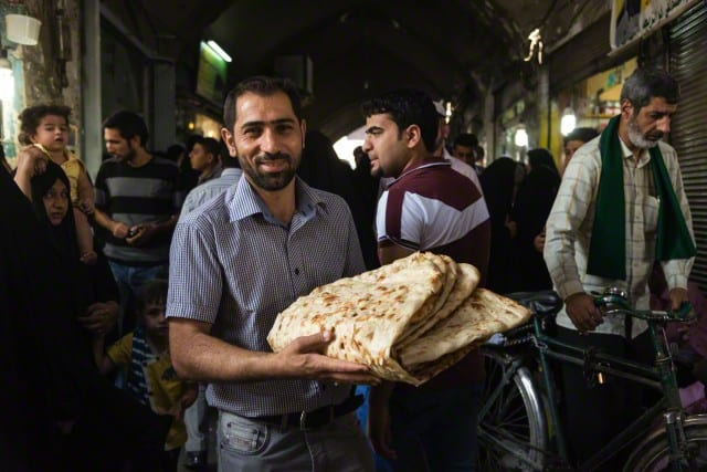 Bread seller in the bazaar Image by Michel Setboun/Corbis
