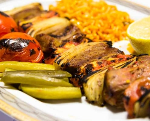 If you would pass Tehran, try Chelo Kebab (Rice with Chicken/Lamb Kebab)