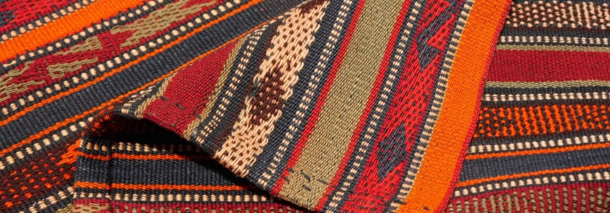 A Jajim is a flat weave made from wool on a horizontal loom. They are usually made in a stripe design in narrow sections which are then stitched together.